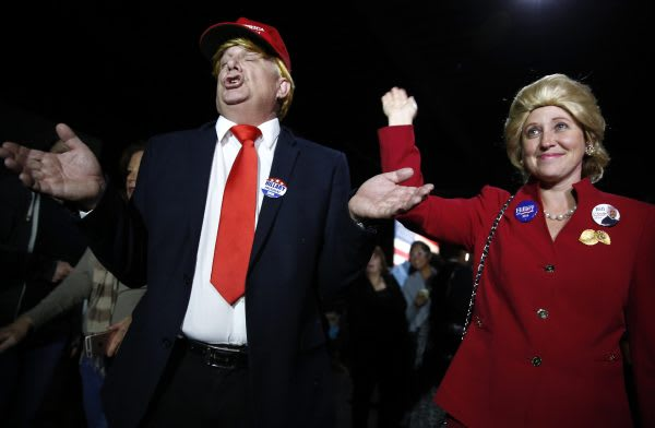 Supporters of Democratic U.S. presidential candidate Hillary Clinton, who came to her rally in costume as Republican presidential candidate Trump and as Mrs. Clinton attend her Super Tuesday night party in Miami