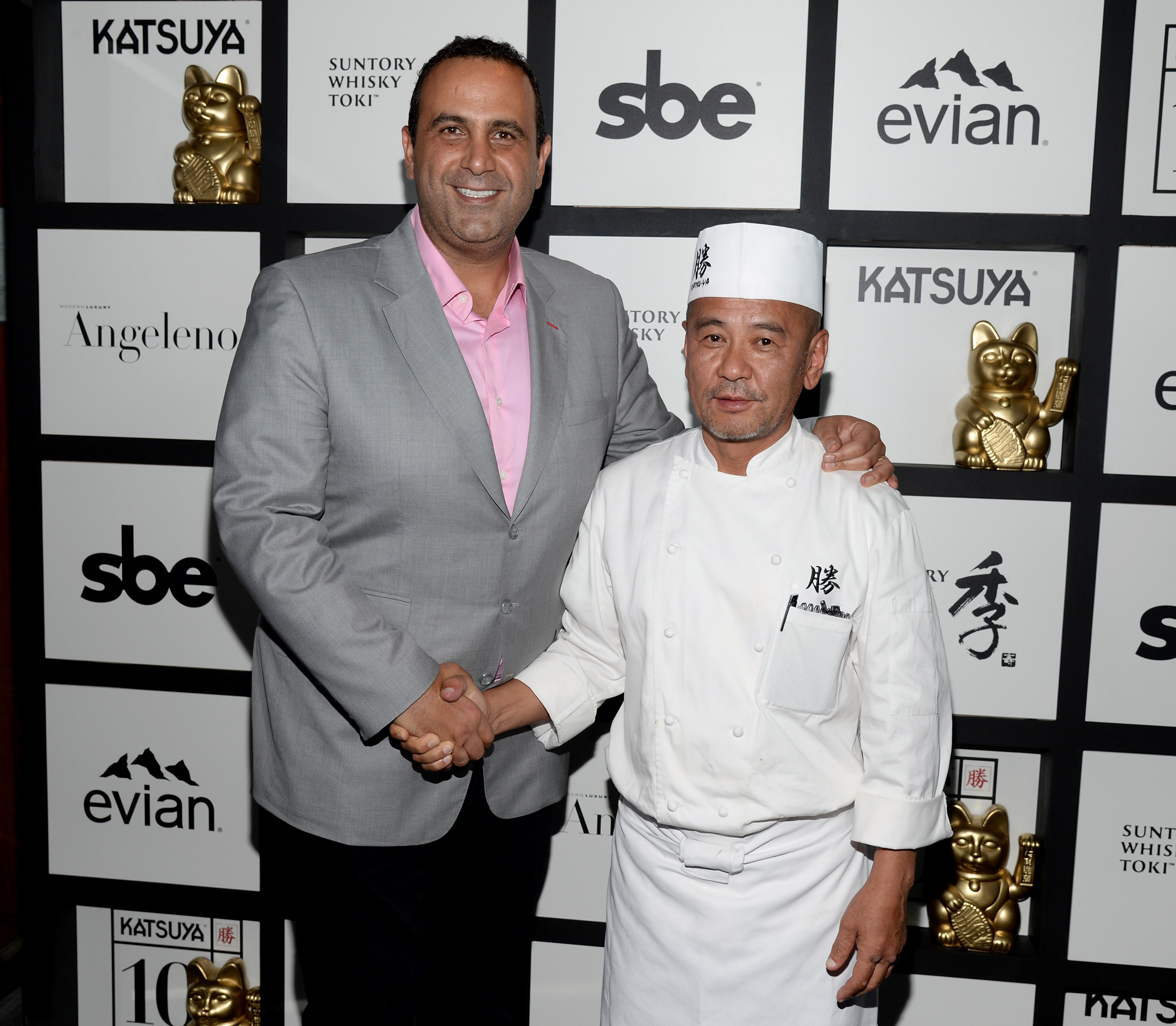 LOS ANGELES, CA - JUNE 15: CEO of sbe Entertainment Group Sam Nazarian (L) and Chef Katsuya Uechi attend Katsuya Brentwood Celebrates A Decade on June 15, 2016 in Los Angeles, California. (Photo by Michael Kovac/Getty Images for Katsuya)
